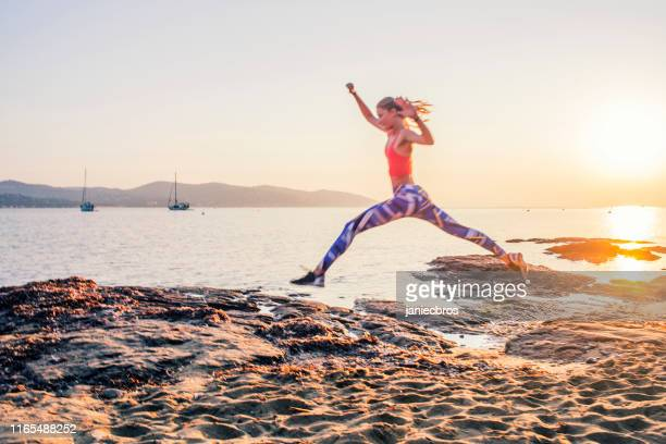 training on a rocky shore - extra long stock pictures, royalty-free photos & images