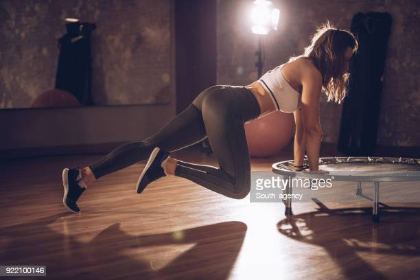 training on trampoline - yoga pants stock photos and pictures