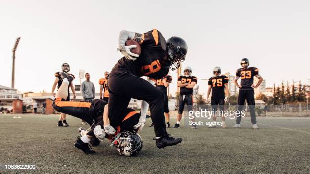 nfl training outdoors - guard american football player stock photos and pictures