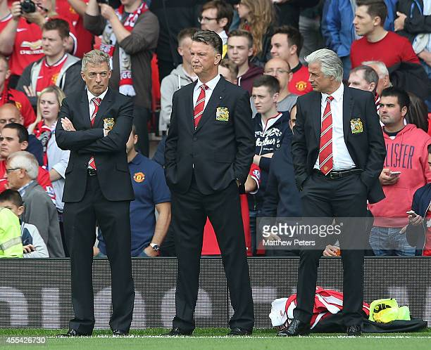 Training physiologist Jos van Dijk, Manager Louis van Gaal and Opposition coach Marcel Bout of Manchester United watch from the touchline ahead of...