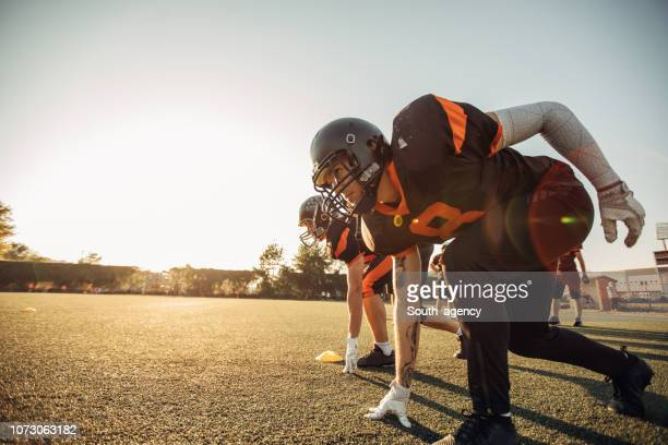 nfl training - practicing stock pictures, royalty-free photos & images