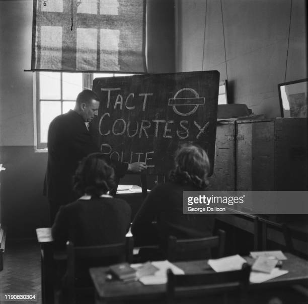 A training school for female bus conductors or 'conductorettes' on London Transport during World War II UK November 1940 Here they are learning the...