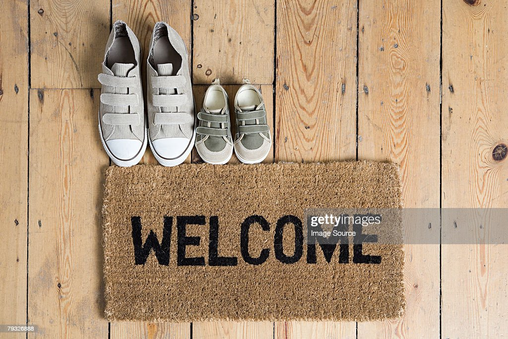 Training shoes and a welcome mat : Stock Photo