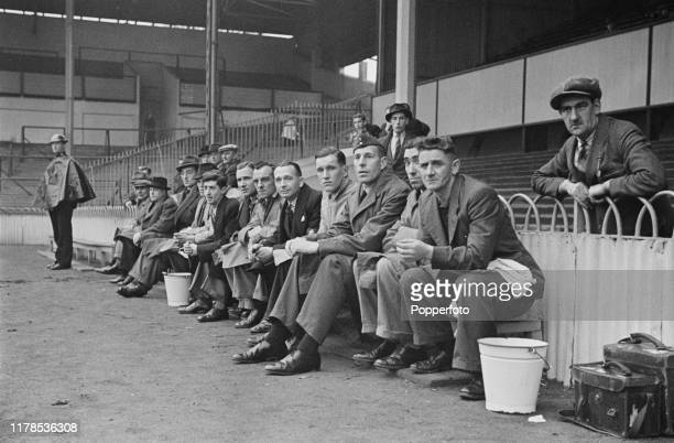 Training staff from both teams watch from the bench the Football League South match between Arsenal and Charlton Athletic at White Hart Lane Stadium...
