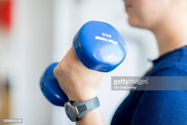 Training with a 5 kg dumbbell in a physiotherapeutic practice on May 25 2018 in BONN GERMANY