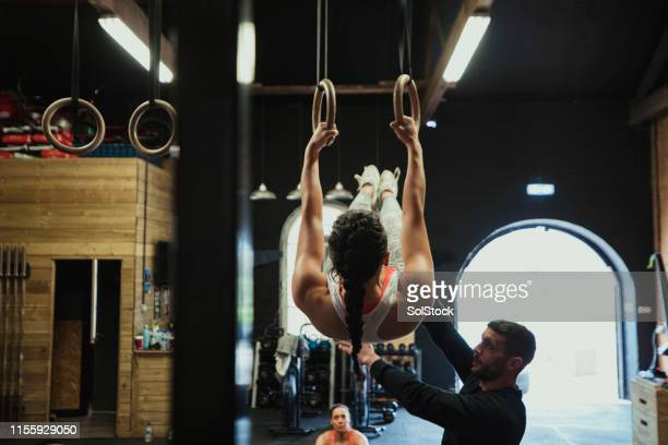 training with gymnastics rings - gymnastics stock pictures, royalty-free photos & images