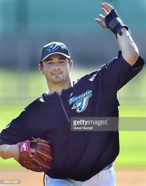 Ted Lilly throws a ghost pitch during fielding practice As the first official workout began for pitchers and catchers at The Toronto Blue Jays...