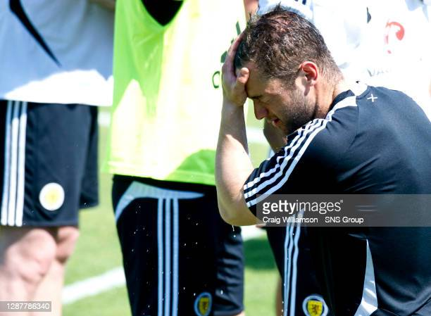 Scotland's Shaun Maloney feels the heat at training as he splashes his face with some water