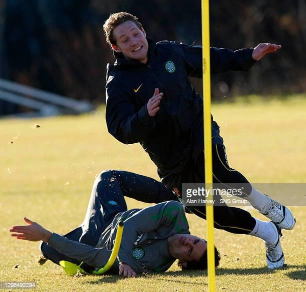 Celtic new Bhoy Kris Commons leaves team-mate Beram Kayal in a heap on the floor