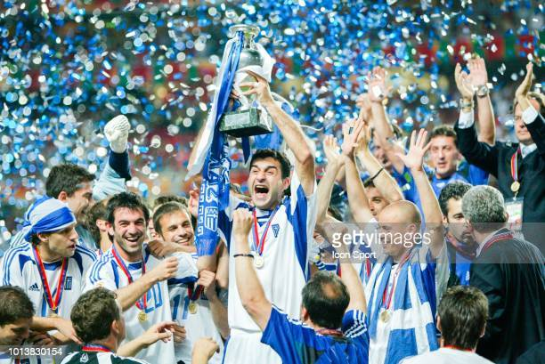 Trainos Dellas of Greece celebrates with team mates during the Euro final match between Portugal and Greece at Estadio da Luz in Lisbon, Portugal on...