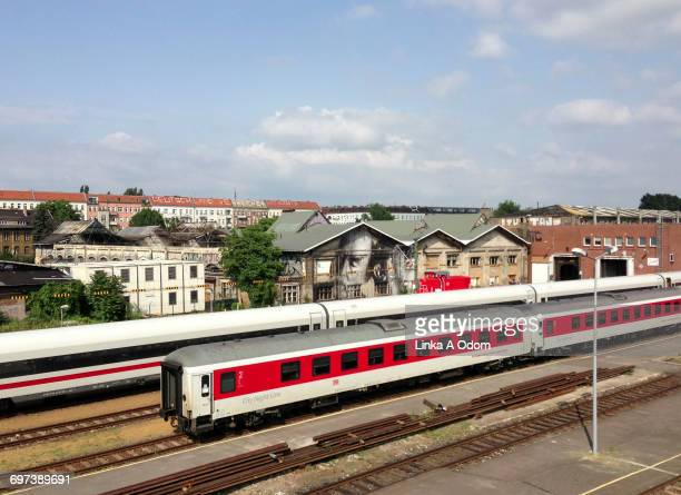 trains and buildings in the city of berlin - friedrichshain stock photos and pictures