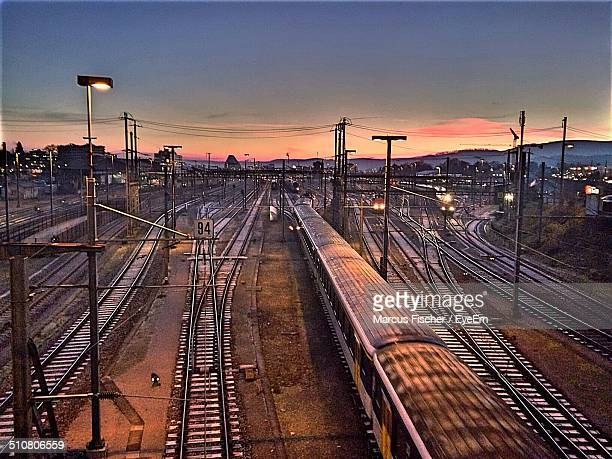 Trains and railroad tracks at sunset