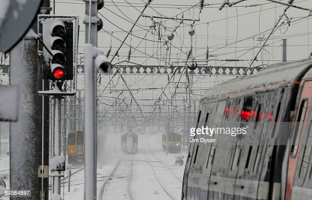 Trains are pictured in snow on the east coast main line at Alexandra Palace station on February 2 2009 in London England The United Kingdom has...