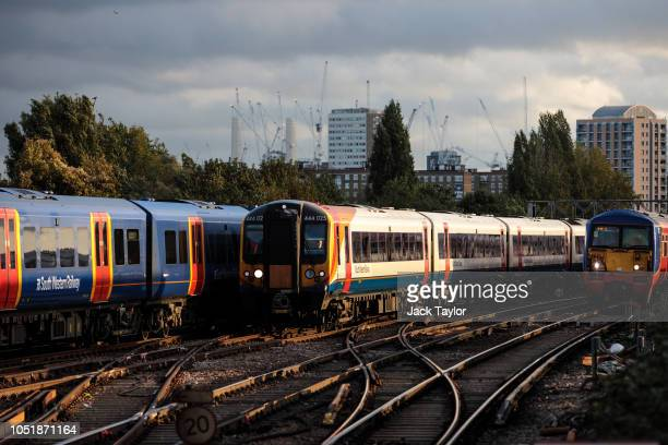 Trains arrive at and depart from Clapham Junction Station during the morning rush hour on October 11 2018 in London England The Office of Road and...
