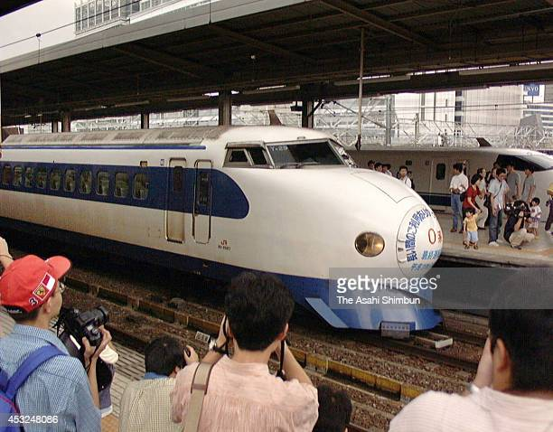Trains fans see off the final '0' series Shinkansen bullet train departing for Tokyo at Nagoya Station on September 18 1999 in Nagoya Aichi Japan