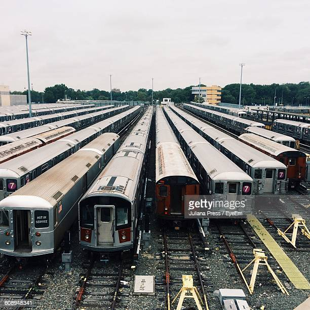 trains in shunting yard against sky - shunting yard stock photos and pictures