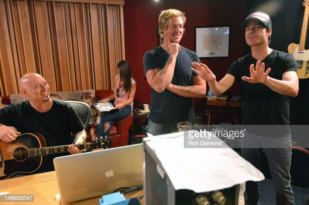 Train's Jimmy Stafford Scott Underwood and Pat Monahan during recording of A Very Special Christmas 25th Anniversary Album at Blackbird Studio on...