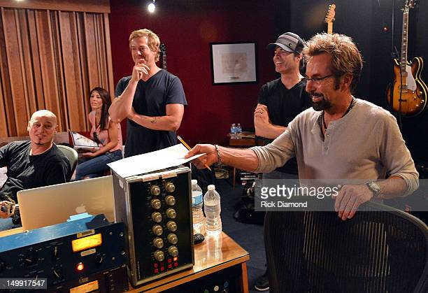 Train's Jimmy Stafford Scott Underwood Pat Monahan and Executive Producer of A Very Special Christmas 25th Anniversary Tony Brown during recording of...