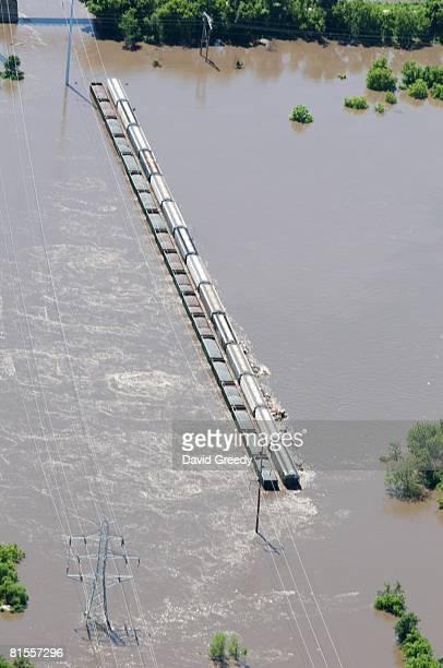 Trains loaded with rock hold down a bridge over the Cedar River June 13, 2008 in Cedar Rapids, Iowa. Flooding along the Cedar River was expected to...