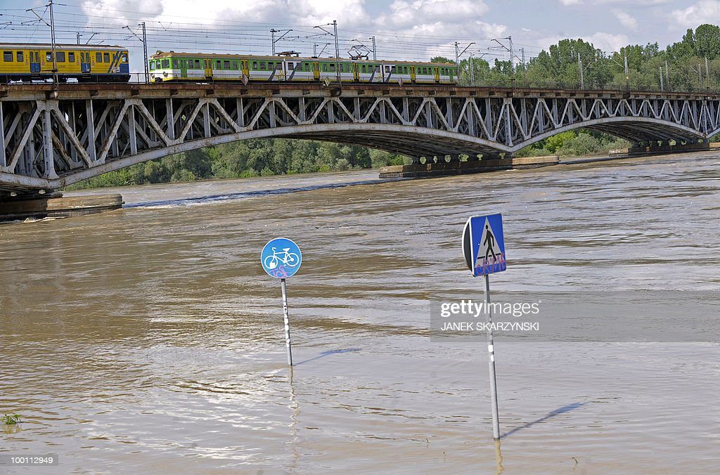 Trains pass on a bridge above flooded waters of Wisla river on May 21, 2010 in Warsaw. Flash floods caused by days heavy rainfall have hit parts of central Europe, killing at least seven people, disrupting power supplies and forcing thousands of people from their homes. Southern Poland, parts of the Czech Republic and Slovakia and northern Hungary are among the worst affected regions.