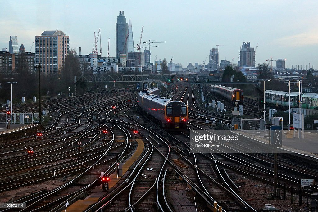 Trains pull into Clapham Junction Station on January 2, 2015 in London, England. Increased rail fares averaging 2.5% come into effect today, pushing the cost of some commuters annual rail fares to more than £5,000. Earlier this week, Network Rail chief executive Mark Carne said that he would not be receiving his annual bonus because of the major rail disruption passengers faced over the Christmas period, which was caused by engineering works that overran.