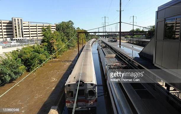 Trains remain idle at the Trenton Transit Center due to water on the tracks from Hurricane Irene August 29 2011 in Trenton New Jersey Rail service is...