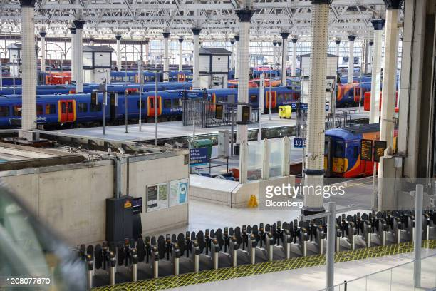 Trains stand at empty platforms at London Waterloo railway station in London, U.K., on Tuesday, March 24, 2020. The U.K. Is in lockdown after Boris...