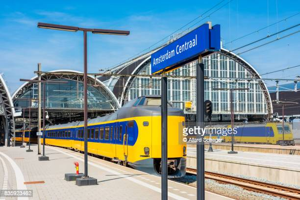 trains stationed on amsterdam central railway station - station stock pictures, royalty-free photos & images