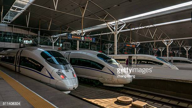 CRH trains stop at a railway station platform About 332 million passengers take trips by CRH train during the year's Spring Festival travel rush...