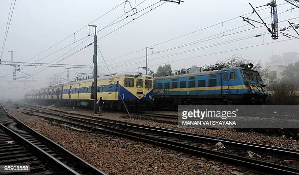 Trains travel along the railway tracks on a foggy morning in New Delhi on January 21 2010 Winter fog during the last days has affected traffic and...