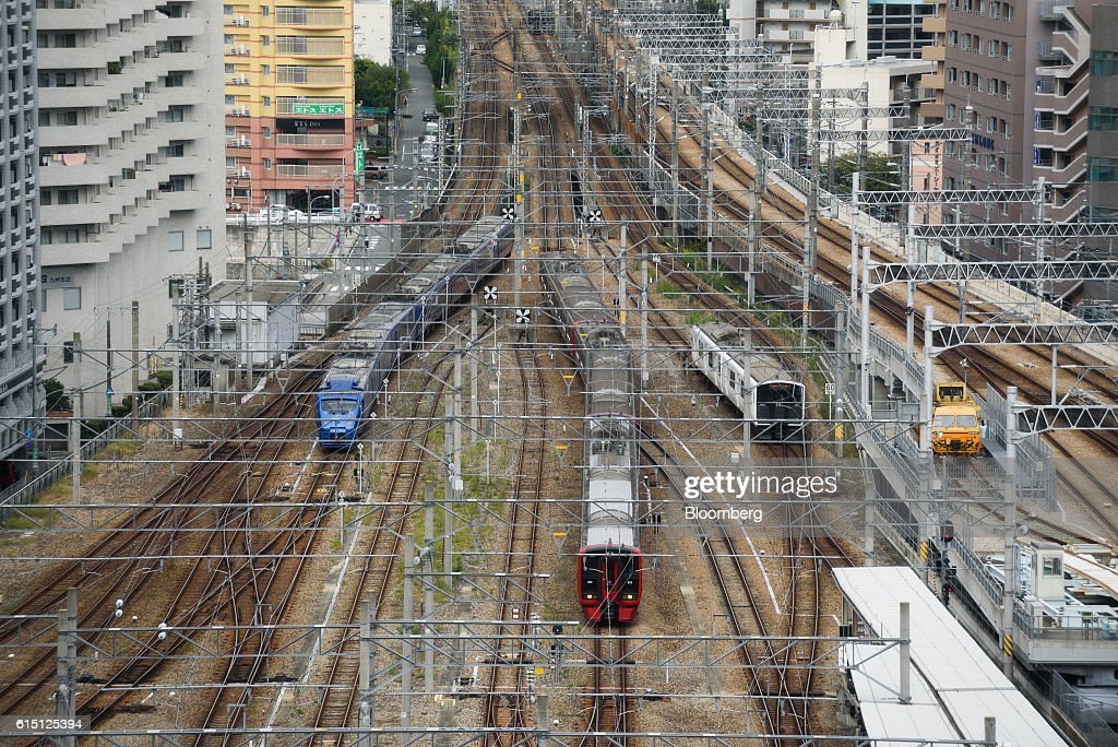 Trains travel along tracks as they approach Hakata Station in Fukuoka, Fukuoka Prefecture, Japan, on Tuesday, Oct. 11, 2016. Kyushu Railway Co., the state-owned bullet-train operator seeking to raise as much as 416 billion yen ($4 billion) in an initial public offering, plans to reduce its reliance on Japan by investing in residential and office properties in Southeast Asia, its chairman said in an interview. Photographer: Akio Kon/Bloomberg via Getty Images