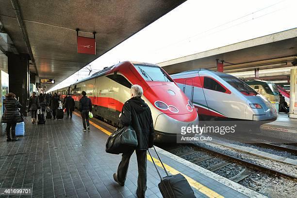 Trains Trenitalia 'Frecciarossa' and 'Frecciargento' in Roma Termini Train Station. 2013 for Trenitalia closes with over 42 million passengers while...