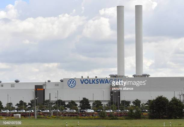 Trains with new cars stand in front of the Volkswagen factory in Zwickau, Gerrmany, 22 August 2016. The supply stop of two parts manufacturers has...