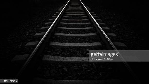 traintrack black and white - railroad track stock pictures, royalty-free photos & images