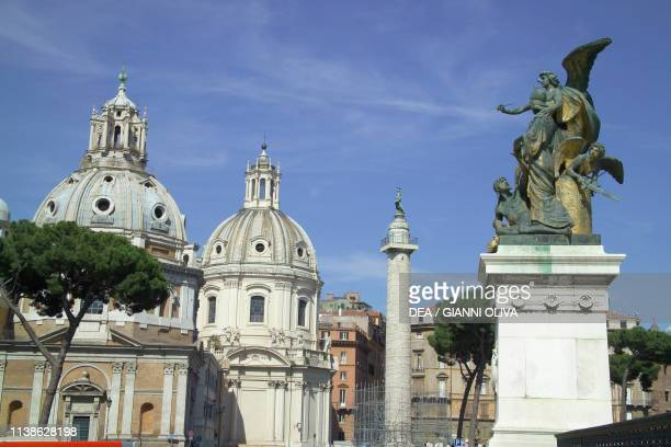 Trajan's Column and the church of Santa Maria di Loreto and the Church of the Most Holy Name of Mary at the Trajan Forum Rome Lazio Italy