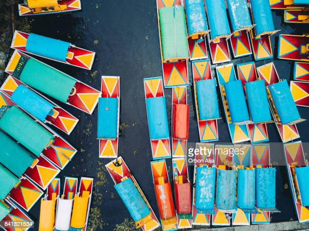 'trajinera' boats in the xochimilco's canals, mexico city. - mexico city aerial stock pictures, royalty-free photos & images