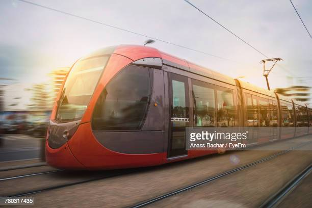 tram against sky during sunset - tram stock photos and pictures