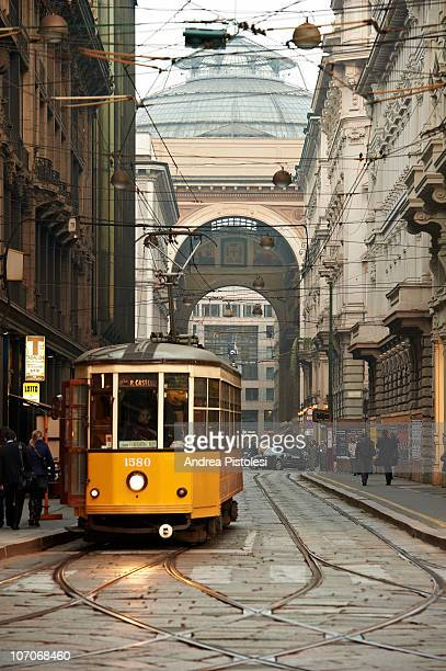 tram and galleria vittorio in milan, italy - milan stock pictures, royalty-free photos & images