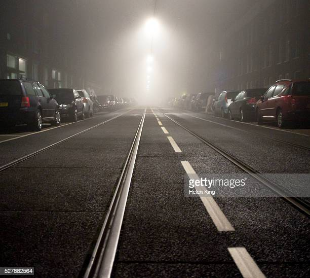 Tram and road markings on misty night