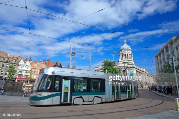 tram at old market square, nottingham - nottingham stock photos and pictures