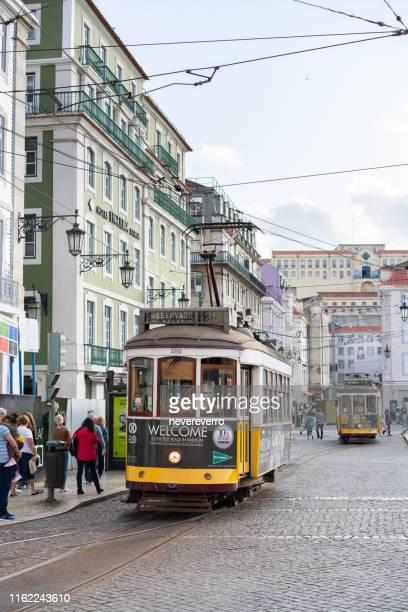 tram at the square in lisbon, portugal - praça do comércio imagens e fotografias de stock