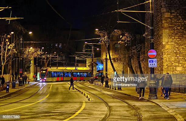 tram between eminonu and sultanahmet at night - emreturanphoto stock pictures, royalty-free photos & images