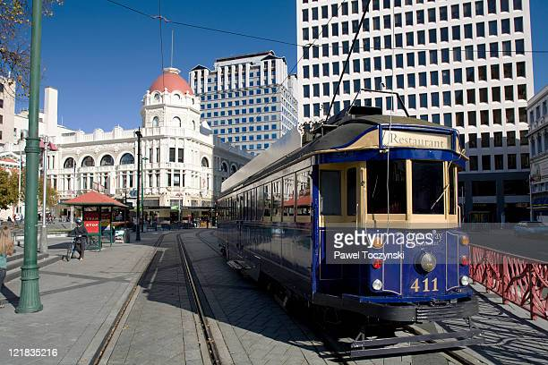 tram, cathedral square, christchurch, south island, new zealand. - christchurch new zealand stock pictures, royalty-free photos & images