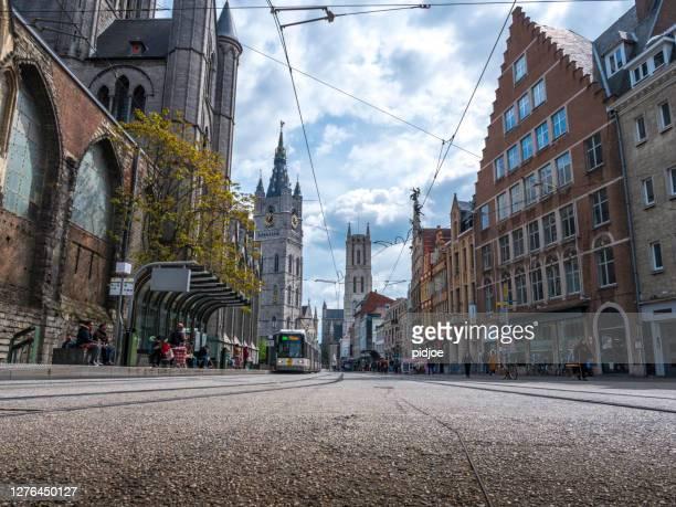 tram circulating in the medieval city of ghent, belgium - flandres oriental imagens e fotografias de stock