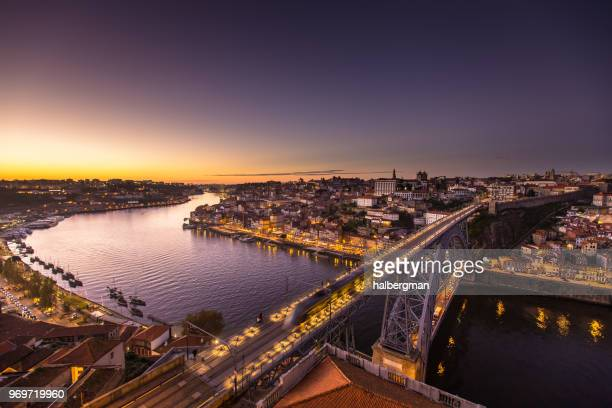 tram crossing from porto to vila nova de gaia at dusk - porto portugal stock pictures, royalty-free photos & images