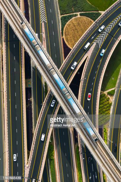 tram crossing over highway, united arab emirates - transport stock pictures, royalty-free photos & images