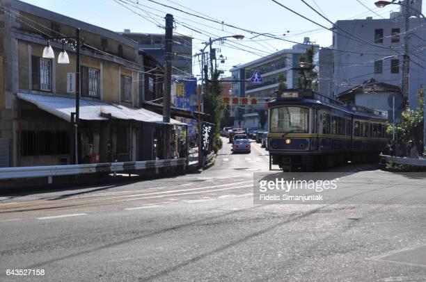 A tram crossing street at Enoshima island area