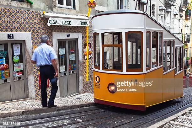 Tram driver and traditional tram at Elevador da Bica in Bairro Alto
