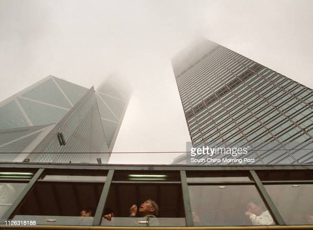A tram drives pass the Bank of China and the Cheung Kong Center in central on Tuesday January 15 2002 as a humid maritime airstream affected the...