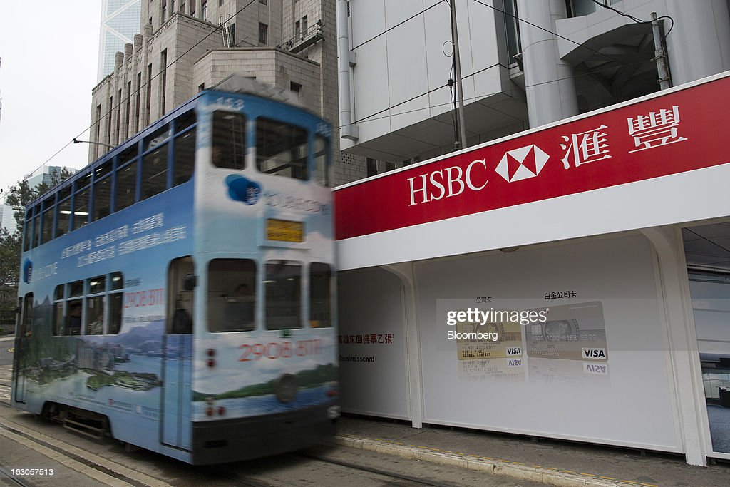 A tram drives past an advertisement for HSBC Holdings Plc in Hong Kong, China, on Saturday, March 2, 2013. HSBC is scheduled to release annual results on March 4. Photographer: Jerome Favre/Bloomberg via Getty Images